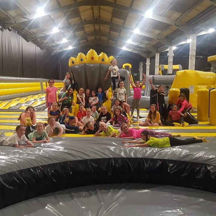 U10 girls footballers having fun